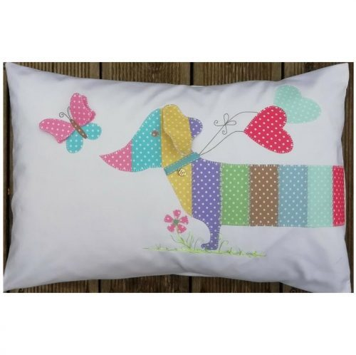 A delightful appliqued sausage dog that can be a cushion or a bag. by Gail Penberthy