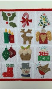 Little Festive Sampler Mini Quilt Pattern designed by Julia Gahagan